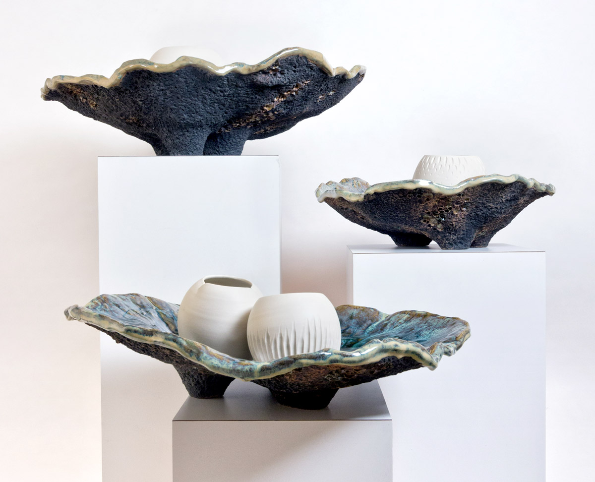 Wanderers glow pots and Ostrea giant shells on display at Night Sea art exhibit