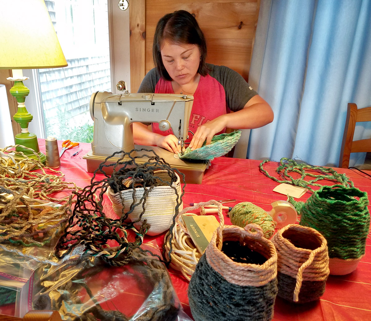 Artist Emily Miller making rope baskets, fiber art sculpture