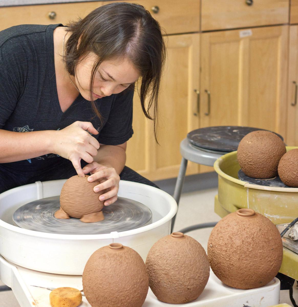 Artist Emily Miller making Lava Pots